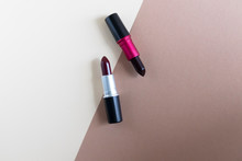 Two Red Shades Of Lipstick On A Beige Background, Lip Cosmetics, Top View Decorative Cosmetics, Copy Space