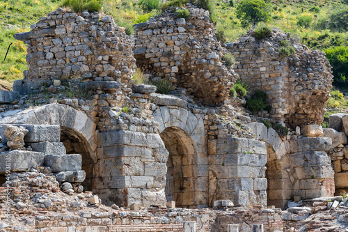 The ruins of the ancient antique city of Ephesus the library building of Celsus, the amphitheater temples and columns Wallpaper Mural