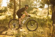 Cyclist Man Riding Mountain Bi...