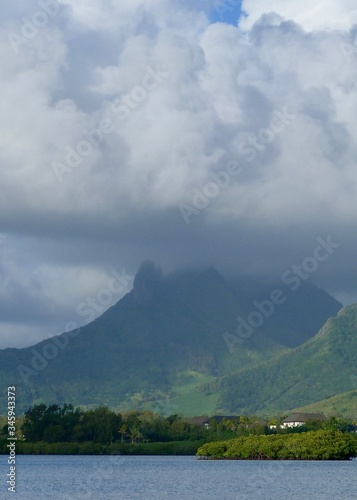 Fototapeta Scenic View Of Lake And Mountains Against Cloudy Sky obraz na płótnie