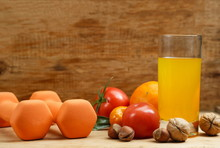 Dumbbell, Orange Juice, Fruit And Nuts On The Wooden Table, Sport And Health Lifestyle Concept