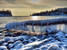 Frozen Ice In Lake Superior Against Sky During Sunset