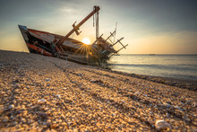 An Abandoned Shipwreck On A Sa...