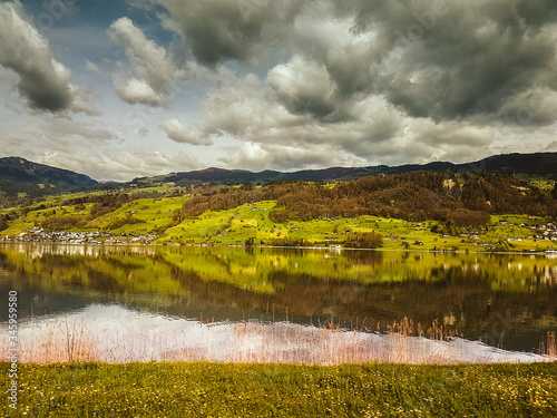 Scenic View Of Landscape Against Dramatic Sky #345959580