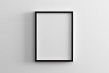 Blank Frame On White Wall Mock...