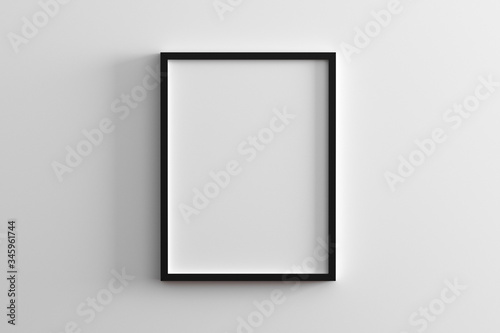 blank frame on white wall mock up, vertical black poster frame on wall,  picture frame isolated on a wall, mock up for picture or photo frame,  empty frame on bright wall, 3d render