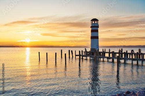 Scenic sunset at idyllic lake Neusiedlersee with old Podersdorf Leuchtturm lighthouse, Burgenland, Austria