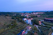 Fragment of a small mountain village in the early morning. Shooting from a drone.