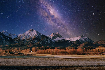 Starry night in mountains with milky way