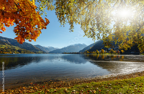 Wall mural - Beautiful Autumn scenery. A beautiful view from Lake Zell. Wonderful Autumn landscape in Alps with Zeller Lake in Zell am See, Salzburger Land, Austria. Natural background. Amazing nature landscape