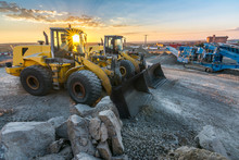 Group Of Excavators At A Const...
