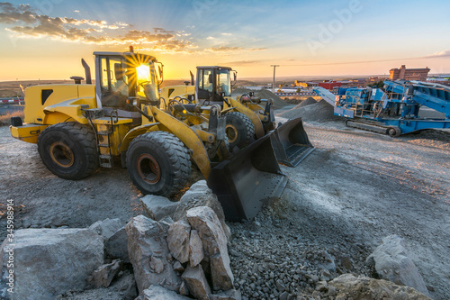 Photo Group of excavators at a construction site