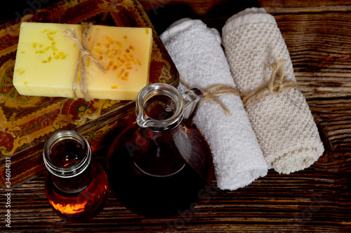 Musky aroma soap, argan oil for the body and clean towels Wallpaper Mural