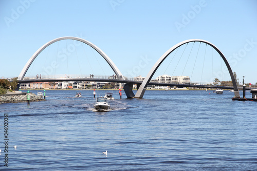 September 8, 2019 - Elizabeth quay, Perth, Western Australia. View of the pedestrian bridge that crosses the mouth of the quay with boats motoring back to the harbour