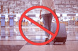 Stop travel in virus outbreak and trip-cancellation concept, Young woman carrying luggage with ignore icon