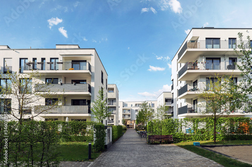 Cityscape of a residential area with modern apartment buildings, new green urban landscape in the city