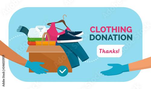 Fényképezés Volunteer giving clothing donation box