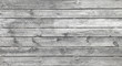 Old horizontal wooden planks, bleached white by the sun. Rustic background texture. Screws along the center.
