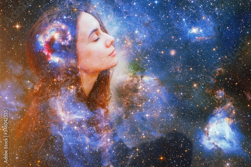 Obraz Double exposure portrait of a young woman close eye face with galaxy space inside head. Human inner peace, star light fire, life zen girl love, rpa ai concept. Elements of this image furnished by NASA - fototapety do salonu
