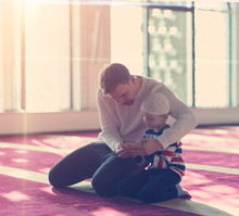 Father And Son In Mosque Prayi...
