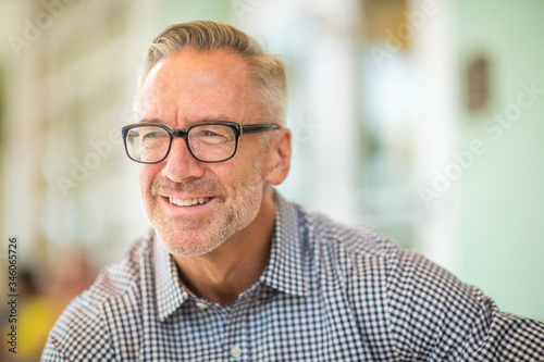 Obraz Mature handome fit man sitting outside stock photo - fototapety do salonu