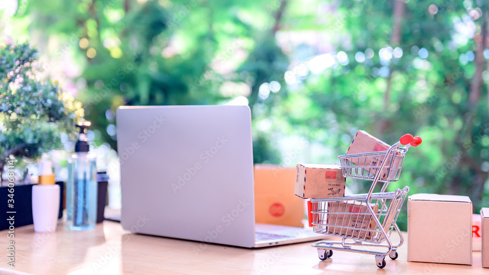 Fototapeta Online shopping and home delivery concept. Lock down and Self-quarantine for work home. SME business and e-commerce effect from Covid-19.