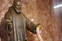 San Giovanni Rotondo - Foggia - Puglia - Italy -18 September 2016 - Statue Of Padre Pio, A Believer Shakes His Holy Hand.