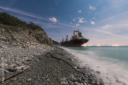 Abandoned broken ship ran aground on shore after storm Wallpaper Mural