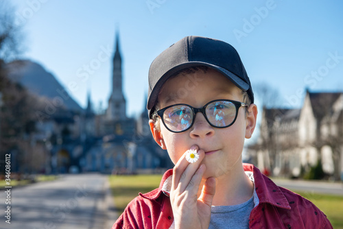 young boy with the basilica of Lourdes in France Wallpaper Mural