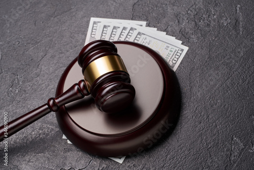 Symbol of court and justice, wooden gavel, dollars Wallpaper Mural