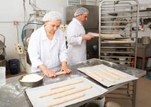 Woman Baker Forming Dough