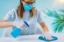Disinfect - Woman Spraying Tab...