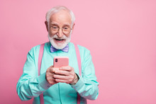 Portrait Of Surprised Crazy Shocked Old Man Use Smartphone Read Social Media News Enjoy Comments Wear Teal Outfit Purple Violet Bow Tie Isolated Pastel Pink Color Background