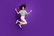 canvas print picture - Full body photo of crazy funny afro american girl jump make v-sign scream feel rejoice wear striped shirt pink outfit isolated over violet color background