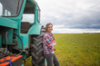 young attractive girl woman working in a field on a tractor, rural profession for young people, rural agriculture business