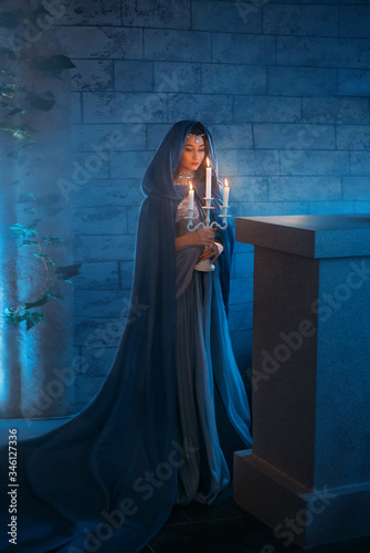 Slika na platnu young woman queen stands in dark night room mysterious castle