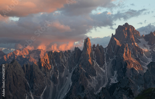 Mountain landscape in the European Dolomite Alps underneath the Three Peaks with alpenglow during sunset, coloured clouds in the sky, South Tyrol Italy Canvas Print