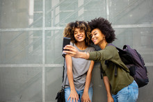 Two Young African American Friends Taking Selfie With Cellphone