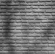 Old vintage brick wall for background. Brick surface template photo. Black and white photo.
