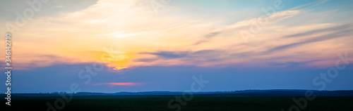 Obraz Wonderful panorama with picturesque clouds over the field during sunset or sunrise - fototapety do salonu