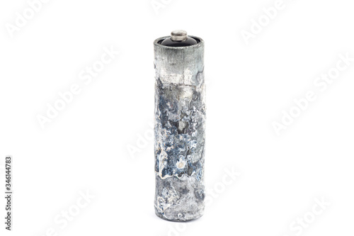 Valokuvatapetti Close-up of a heavily oxidized unwrapped AA battery isolated on white