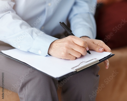 Fototapety, obrazy: Unrecognizable Professional Psychologist Taking Notes Sitting On Couch In Office