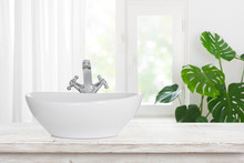 Modern Wash Basin With Shiny Faucet On Vintage Bathroom Table