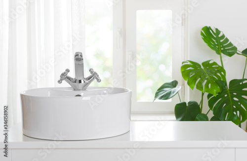 Cuadros en Lienzo Hygienic wash basin with chrome faucet on bathroom window background