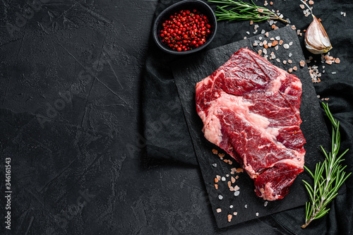 Fototapeta Raw beef fillet steak. Organic farm meat. Black background.