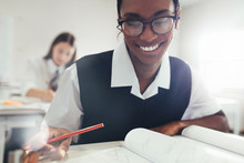 Female Student Smiling While S...