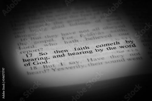 Photo Faith Comes by Hearing Bible Scripture Illuminated on Page