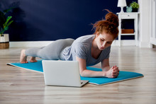 Redhead Woman Doing Some Yoga ...