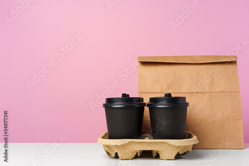 Fototapeta Paper bags with take away food and coffee cups containers. Lunch box obraz
