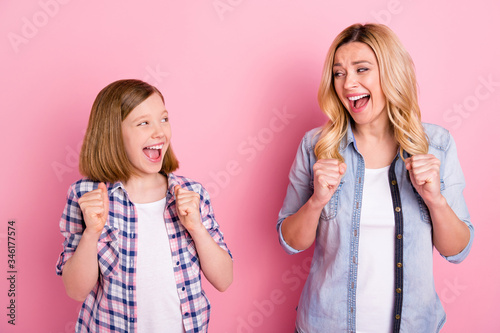 Vászonkép Portrait of delighted mother daughter hear incredible covid-19 win look impresse